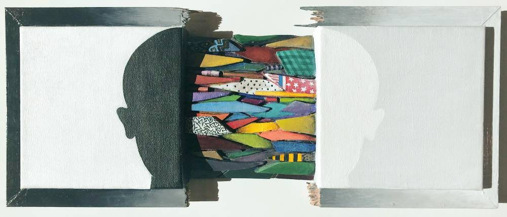 Sculpture depicting a canvas broken down the center with fragments of wooden multi-colored and patterned pieces between the canvas pieces, each canvas depicts half a silhouette, left side silhouette is black on a white background, the right side is white